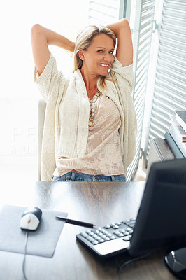 Buy stock photo Happy mature business woman relaxing in front of computer at work desk