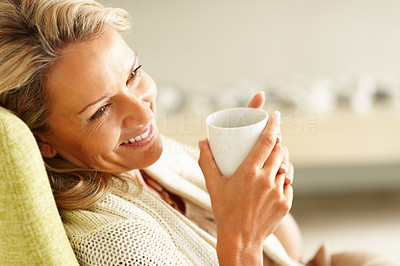 Buy stock photo Macro view of a beautiful middle aged woman holding a cup of tea or coffee and smiling