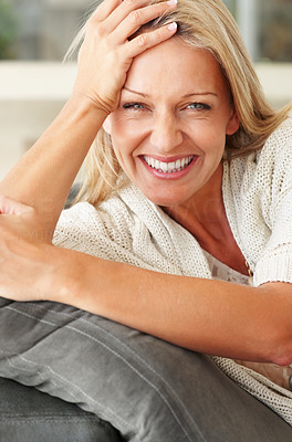 Buy stock photo Closeup portrait of a cute middle aged female giving you a warm smile