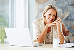 Cheerful woman with laptop and tea cup - copyspace
