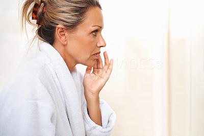 Buy stock photo Side view of a beautiful mature lady admiring herself in the mirror