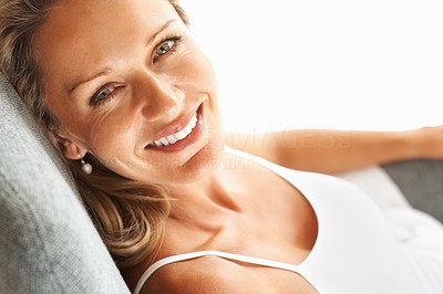 Buy stock photo Closeup portrait of a beautiful middle aged woman giving you a warm smile as she is relaxing - copyspace