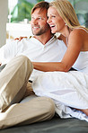 Happy relaxed mature couple looking at something and smiling