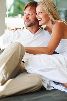 Buy stock photo Happy relaxed mature man and woman looking at something and smiling