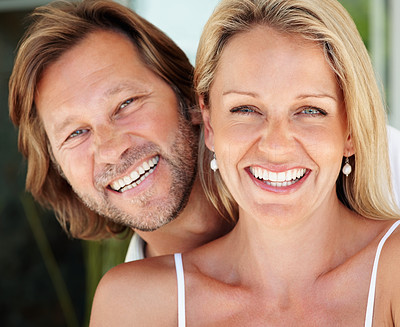 Buy stock photo Closeup portrait of a sweet loving couple smiling together