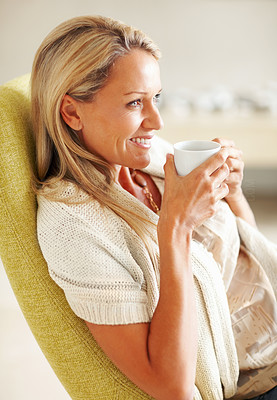 Buy stock photo Side view portrait of a mature woman in happy thoughts drinking tea