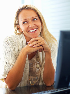 Buy stock photo Portrait of a casual mature female in happy thoughts at work desk