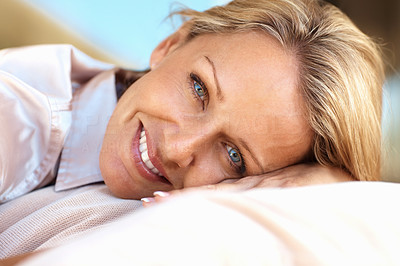 Buy stock photo Closeup portrait of a beautiful relaxed mature woman smiling