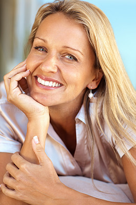 Buy stock photo Closeup portrait of a happy mid adult woman with hand on chin relaxing