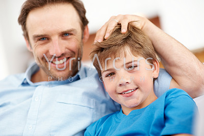 Buy stock photo Closeup portrait of a cute little and his father relaxing together at home - Indoor