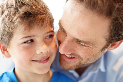 Buy stock photo Closeup portrait of a happy young man and his son looking at each other
