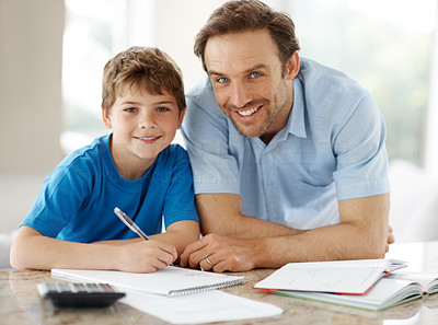 Buy stock photo Portrait of a smiling young father helping to his son doing homework - Indoor