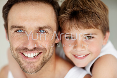 Buy stock photo Closeup portrait of a happy young father and his son smiling