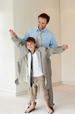 Buy stock photo Portrait of a little young boy standing on his father`s feet and dancing