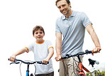 Caucasian father and son standing with bicycle