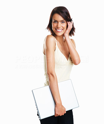 Buy stock photo Isolated studio shot of a college girl carrying a laptop with a cute smile