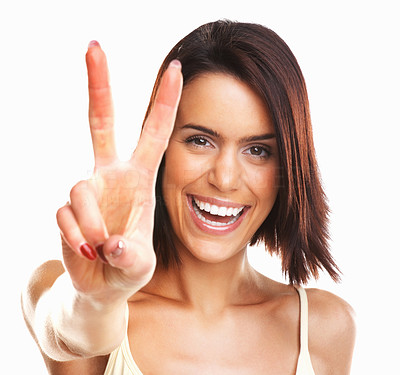 Buy stock photo Cute cheerful woman showing the peace / victory hand sign against white background