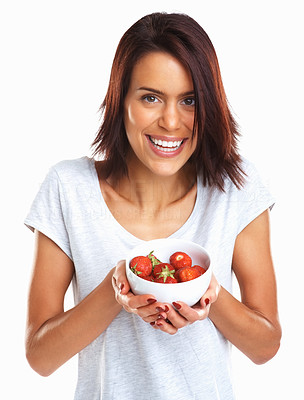 Buy stock photo Happy mixed race girl giving you a bowl of fresh strawberries against white background