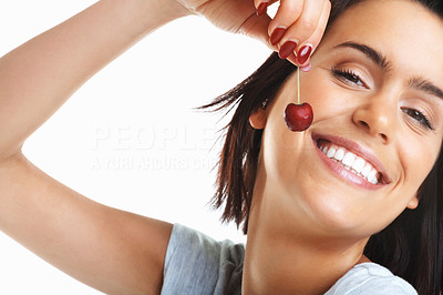 Buy stock photo Portrait of a smiling girl holding a cherry isolated against white background