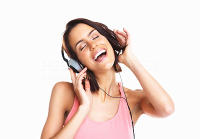 Buy stock photo Portrait of a young woman listening to music and singing with eyes closed against white background