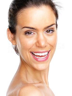 Buy stock photo Closeup portrait of a beautiful young female model smiling against white background