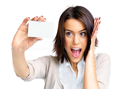 Buy stock photo Portrait of a excited young female holding a small blank card against white background