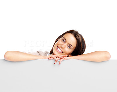 Buy stock photo Portrait of an happy young woman leaning on blank board against white bacKground