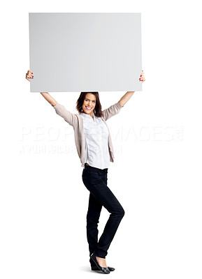 Buy stock photo Full length portrait of a happy young female holding up a blank billboard above her head against white background
