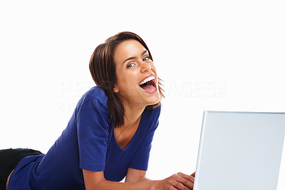 Buy stock photo Happy beautiful student lying on floor and laughing while using laptop against white