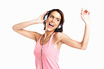 Young attractive woman dancing to music with headphones