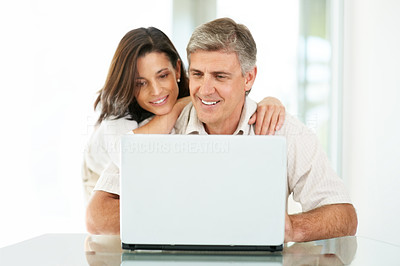 Buy stock photo Portrait of a lovely mature couple using laptop computer at home