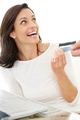 Buy stock photo Portrait of a happy woman taking credit card from man's hand for online shopping