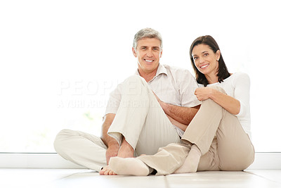 Buy stock photo Portrait of happy mature couple sitting together and smiling
