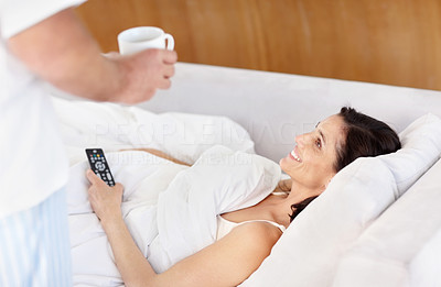 Buy stock photo Portrait of a beautiful mature woman being served coffee in bed by a man