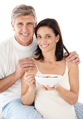 Buy stock photo Portrait of happy mature lady having breakfast with her husband