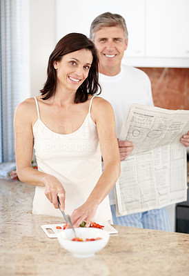 Buy stock photo Portrait of a happy mature woman making fruit salad with her husband