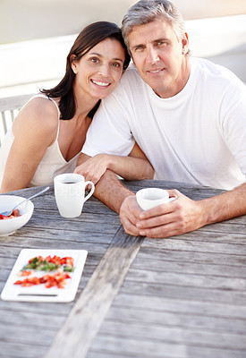 Buy stock photo Portrait of happy mature couple having fruit salad and coffee together