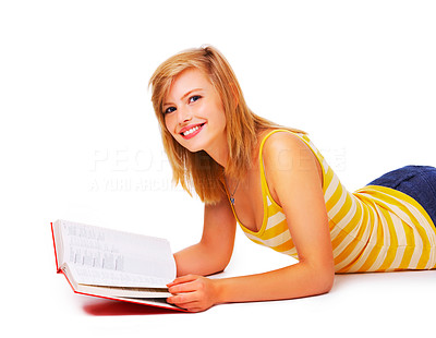 Buy stock photo Portrait of a young cute student studying in her book. This isolate was taken in our studio.