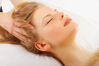 Buy stock photo Shot of a young woman getting a head massage