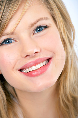 Buy stock photo Closeup portrait of a truly beautiful young woman smiling warmly at you