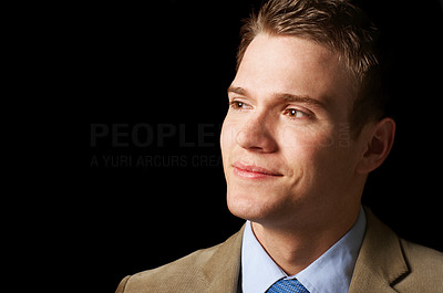 Buy stock photo Portrait of an aspiring young business man isolated on black.