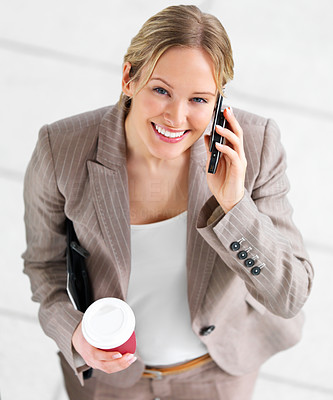 Buy stock photo Portrait of a young beautiful woman using cell phone and drinking coffee