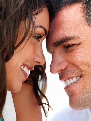 Buy stock photo Close up of a smiling young couple in love with their faces close together