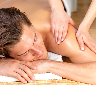 Buy stock photo Happy handsome man getting a back massage