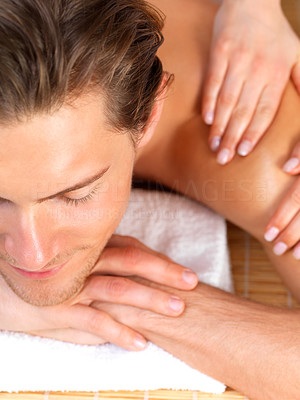 Buy stock photo Close up of a happy young man with eyes closed receiving shoulder massage