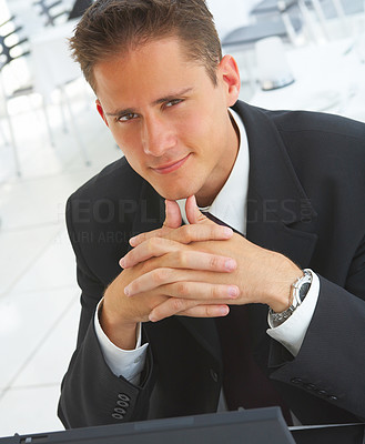 Buy stock photo Shot of businessman working on a laptop in an airport cafe