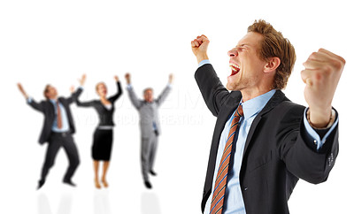 Buy stock photo A group of happy businesspeople standing behind an excited young man with arms over their head in joy.