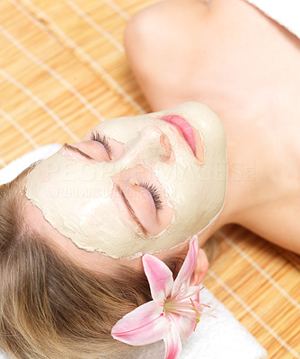 Buy stock photo Portrait of a beautiful young woman wearing facial mud mask at the spa