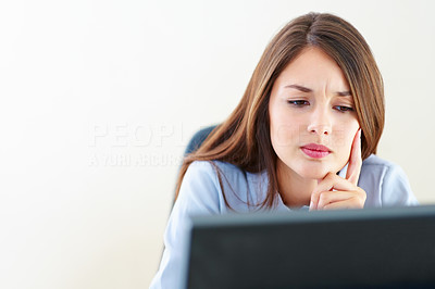 Buy stock photo Thoughtful businesswoman working on computer - copyspace