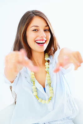 Buy stock photo Portrait of happy smiling girl pointing at you with both hands over white background